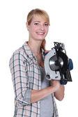 Woman with a circular saw — Stock Photo
