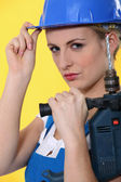 Portrait of a woman with drill — Stock Photo