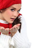 Woman blowing kisses in air — Stock Photo