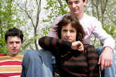Moody teenagers posing with their father — Stock Photo