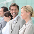 Group of office workers in line — Stock Photo