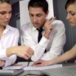 Three colleagues in business meeting - Stock Photo