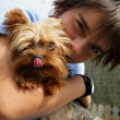 Little boy with pet dog — Stock Photo