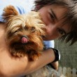Stock Photo: Little boy with pet dog