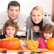 Stock Photo: Family carving Halloween pumpkins.