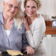 Royalty-Free Stock Photo: Mother and daughter cooking crepes together