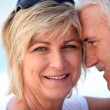 Middle-aged couple at the beach — Stock Photo #8931090