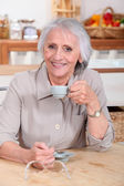 Senior woman drinking coffee — Stock Photo