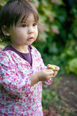 Little toddler exploring in the garden — Stock Photo