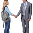 Stock Photo: Girl shaking hand with man