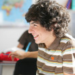 Teens in classroom — Stock Photo