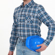 Stock Photo: Worker holding hard hat