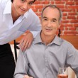 Grandfather with grandson at restaurant — Stock Photo