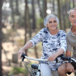 A mature couple on a bike ride. — Stock Photo