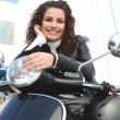 Stock Photo: Woman riding a motorcycle