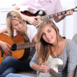 Young playing guitars — Stock Photo