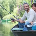 Couple in row boat fishing — Stock Photo