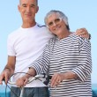 Elderly couple out for a bike ride — Stock Photo