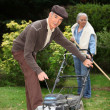 Elderly couple gardening - Stock Photo