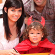 Parents and a little boy dressed in devil — Stock Photo