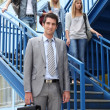 Students and teacher in stairs — Stock Photo