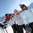 Two couples skiing together — Stock Photo #8957473