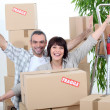 Excited couple on moving day — Stock Photo #8957512