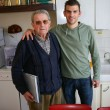Stock Photo: Father and son in kitchen