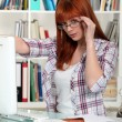 Stock Photo: Womworking at home