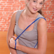 Woman with a skipping rope — Stock Photo #8958233