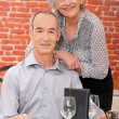 Elderly couple at restaurant — Stock Photo