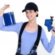 Woman holding paint sprayer — Stock Photo