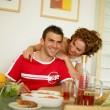 Young couple having breakfast - Foto Stock