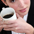 Close-up picture of a woman drinking coffee. — Stock Photo