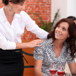 Waitress serving female customer — Stock Photo