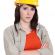 Woman with yellow helmet - Stock Photo