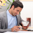 Business at home having coffee before work — Stock Photo