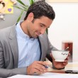 Business at home having coffee before work — Stock Photo #8959561