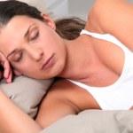 Young woman deeply asleep — Stock Photo