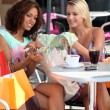 Shoppers in a cafe — Stock Photo