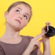 Wishful girl with an empty coin purse — Stock Photo #8959911