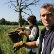 Farmer and wife in field — Stock Photo