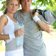 Portrait of sporty couple with bottle of water — Stock Photo #8959983