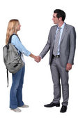 Girl shaking hand with man — Stock Photo