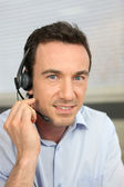 Man using a telephone headset — Stock Photo