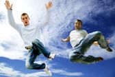 Two young men jumping in the air — Stock Photo