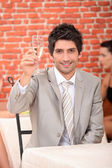 Man raising glass of champagne — Stock Photo
