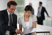 Businesspeople reviewing paperwork — Stock Photo