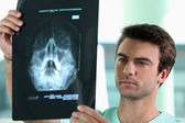 Doctor watching X-ray — Stock Photo