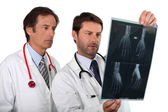 Doctors examining x-ray — Stock Photo